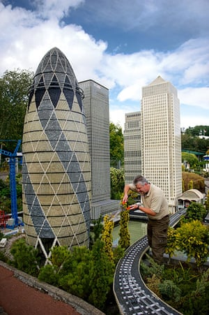 Legoland gallery: Landscape Technician John Isted trims the plants around the model Gherkin