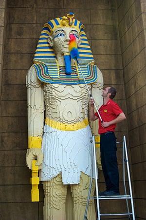 Legoland gallery:  Model Maker Chris Convoy cleans the 6m high pharaoh