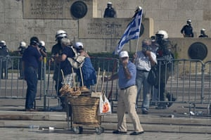 Greece protests updates: A street vendor and tourists escape teargas