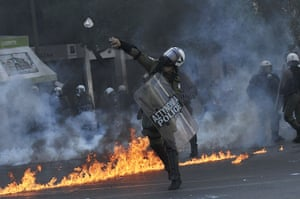 Greece protests updates: A police officer throws a stone toward demonstrators