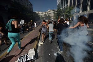 Greece protests updates: Demonstrators run away from teargas shot by riot police