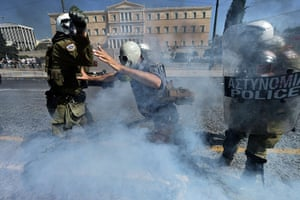 Greece protests updates: A masekd demonstrator clashes with riot police