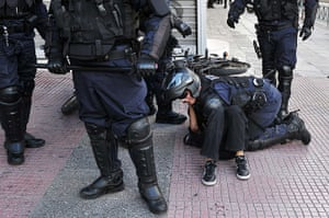 Greece protests updates: Police arrest a demonstrator on the ground