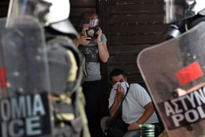 Greece protests updates: Demonstrators take shelter and react to teargas shot