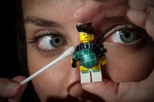 Legoland gallery: Lauren Moss cleans Lego mini figures