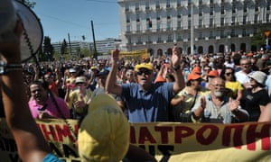 Protestors chant slogans in front of the parliament on September 26, 2012 during a 24-hours general strike in Athens.