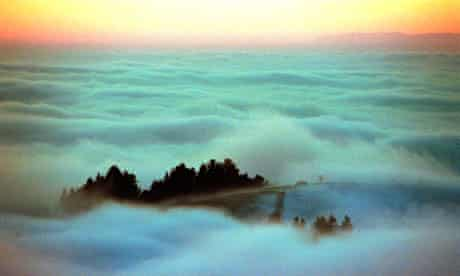 A mountain peak above the clouds