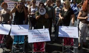 Demonstrators shout slogans on September 26, 2012 in Athens during a 24-hours general strike.