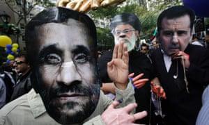 Men wearing masks of Iranian President Mahmoud Ahmadinejad, Iranian Ayatollah Ali Khamenei and Syrian President Bashar al-Assad, outside the United Nations.