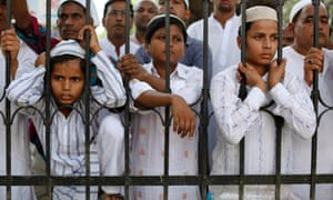 Indian Muslims  in Varanasi, watch relatives and neighbors leave for the annual Hajj pilgrimage to the holy city of Mecca.