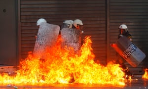 Greek police surrounded by fire, tens of thousands took to the streets in Greece's biggest anti-austerity demonstration in months.