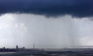 Rain showers move towards Portsmouth and its landmark Spinnaker Tower.