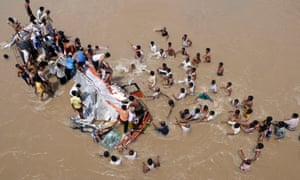 Rescue operations after a bus plunged into the Purna River in Maharashtra's Buldhana district, about 372 miles northwest of Mumbai. 19 people died when the bus fell into the river.