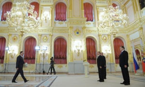 Bulgaria's ambassador to Russia, Boiko Kocev presents his diplomatic credentials to Russia's president Vladimir Putin during a ceremony at Moscow's Kremlin.