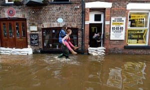 Looters of flooded shop condemned by police | UK news | The