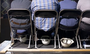 Employees of American Spring Wire listen to Republican presidential candidate, former Massachusetts Governor Mitt Romney speak during a campaign stop in Bedford Heights, Ohio