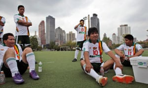 Bolivia's President Evo Morales (2nd R) rests with his teammates at the end of the first half of their friendly soccer match between his team and top officials, staff members and ambassadors to the UN for ending Violence Against Women, during the 67th United Nations General Assembly in New York.