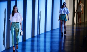Models present creations by Mugler during the Spring/Summer 2013 ready-to-wear collection show in Paris.