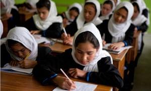 Afghan schoolgirls attend a class