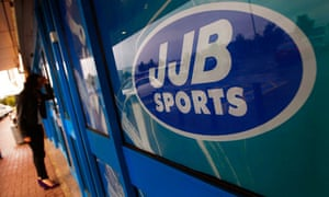 A woman looks in the window of a closed-down JJB Sports store in Edinburgh, Scotland