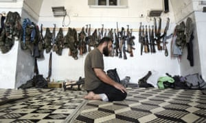 A Free Syrian Army fighter prays at the Kastal Al Hrami's mosque in Aleppo, on 27 September 2012.