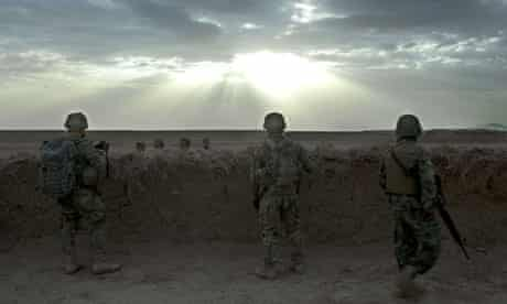 Two US soldiers and an Afghan colleague (right) in Daman district, Kandahar