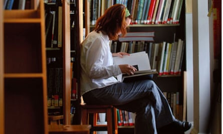 A STUDENT READING IN THE LIBRARY