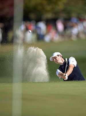 golf12: Justin Rose of England hits out of the b