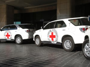 Vehicles wait to transport Peter Maurer, president of the International Committee of the Red Cross (ICRC), for a meeting with Syria's President  Bashar al-Assad in Damascus September 4, 2012.