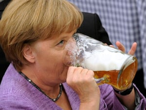 German Chancellor Angela Merkel drinks beer in a beer tent during a fair in Abensberg, southern Germany, Monday, Sept. 3, 2012.