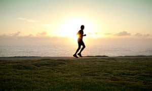 Jogger running alone with sun on horizon. Image shot 2010. Exact date unknown.