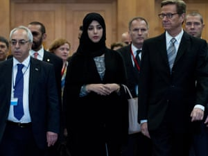 President of the Syrian National Council Abdul Basset Sayda (L), United Arab Emirates Minister of State Reem Al Hashimi (C) and German foreign minister Guido Westerwelle (R) arrive for the second working group meeting on Economic Recovery and Development of the Group of Friends of the Syrian People in Berlin.