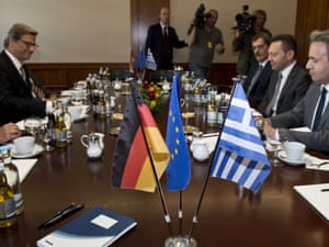 German Foreign Minister Guido Westerwelle (2nd from L) and Greek Finance Minister Yannis Stournaras (2nd from R) hold talks