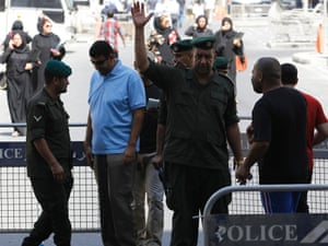 Security personnel stood guard outside the court when life sentences against activists were upheld. The verdicts could fuel political tensions in the kingdom.