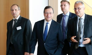 European Central Bank (ECB) President Mario Draghi (C) arrives at the European Parliament's Economic and Monetary Affairs Committee in Brussels September 3, 2012.
