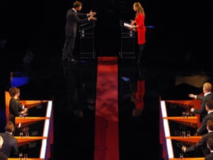Dutch party leader of the People's Party for Freedom and Democracy (VVD) and Prime Minister Mark Rutte (top,L) answers questions from presenter Petra Greys during a TV debate at the Carre theater in Amsterdam, The Netherlands, 04 September 2012.