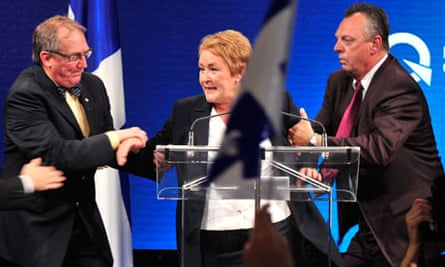 Pauline Marois is whisked off stage