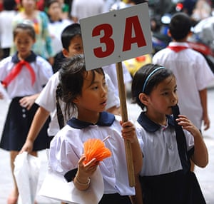 24 hours: Hanoi, Vietnam: Pupils leave a ceremony to mark the new school year