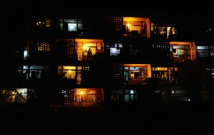 24 hours: Mazar-i-Sharif, Afghanistan: An Afghan resident stands on his balcony