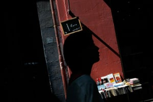 24 hours: Madrid, Spain: A woman walks past a sign advertising books for one euro