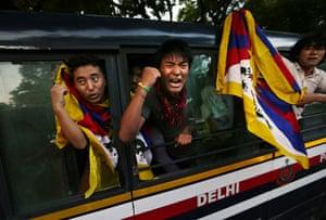 24 hours: New Delhi, India: Tibetan exiles shout slogans