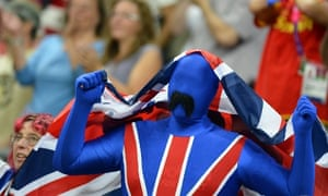 A spectator in a Union Flag suit watches the pool phase group A wheelchair rugby match between Britain and the US.