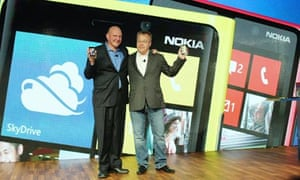 Steve Ballmer of Microsoft (left) and Stephen Elop of Nokia with Nokia's new smartphones