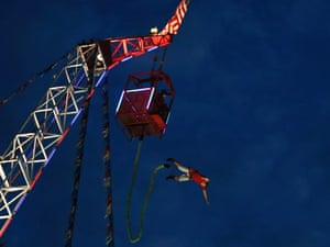 A man bungee jumps at the Los Angeles County Fair in Pomona, California last night. The nation's largest county fair, running from August 31 to September 30, is celebrating its 90th anniversary.
