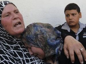 Relatives of Ihab and Akram al-Zaanin, mourn their death.