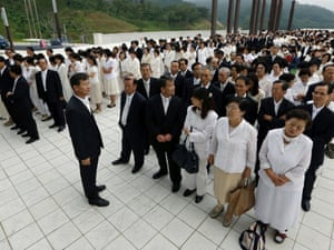 Mourners line up for a memorial service for the late Rev. Sun Myung Moon at the CheongShim peace world centre in Gapyeong, South Korea, this morning.