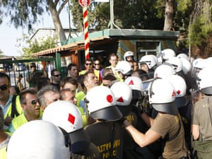 Police officers blocked the main gate of the Riot police school, preventing the movement of riot police to be transferred in view of the Thessaloniki International Fair. Escalating mobilizations of police protesting the upcoming cuts in their salaries.