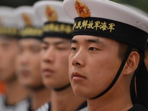 Chinese sailors form an honour guard as they wait for the arrival of the Singapore Prime Minister Lee Hsien Loong during his welcoming ceremony at the Great Hall of the People in Beijing this morning.