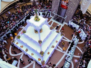 People look at a three-ton cake in the resort city of Baguio, in northern Philippines this morning. The cake, capable of feeding 18,000 people, is part of an annual culinary and tourism show by the Hotel and restaurant association of Baguio city.