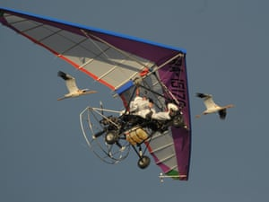 Vladimir Putin, front and a copilot in a motorized hang glider lead Siberian white cranes on a migration route over an Arctic wilderness toward their winter habitat. The Russian president visited an endangered bird sanctuary in Yamal on his way to the APEC 2012 summit in Vladivostok.